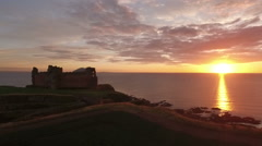 Stunning aerial shot Tantallon Castle off the coast of North Berick, Scotland Stock Footage