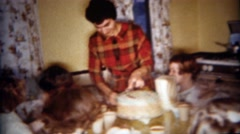 1962: Mother serving birthday cake little girls party. BUFFALO, NEW YORK - stock footage