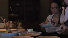 Waiters and chefs working at a busy restaurant serving up desserts - stock footage
