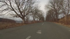 Gray gloomy day. Car moving in a narrow deserted road. - stock footage