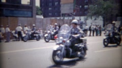1962: Police motorcycle group parade through downtown city. BUFFALO, NEW YORK Stock Footage