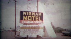 1957: Famous Wigwam Motel sign and teepee room lodging.   SAN BERNARDINO, Stock Footage
