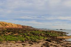 Rock and beach at Stonehaven bay Aberdeenshire, Scotland, UK Stock Photos