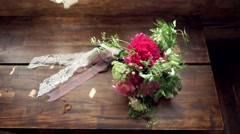 Wedding bouquet on a beautiful wooden surface Stock Footage
