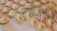 Cooking and sculpting dumplings Stock Footage