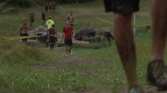 Young Athletes Competing in an Adventure Race with Obstacle course Stock Footage