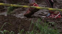 Stock Video Footage of Young runner stepping in mud getting psyched up - motivation
