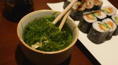 Seaweed salad and sushi - stock footage