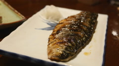 Grilled mackerel on white plate Stock Footage