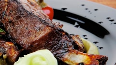 Sawory on black: grilled ribs Stock Footage