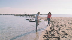 Young adult women walking by the beach in summer Stock Footage