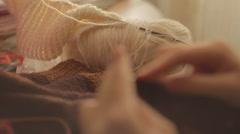 Closeup shot of a woman knitting at home Stock Footage
