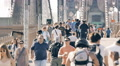 Crowd pedestrians tourists Brooklyn Bridge people New York City NYC slow motion Footage
