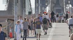Brooklyn Bridge crowd people pedestrians New York City NYC sunny day slow motion - stock footage