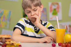 Child dislike healthy lunch Stock Photos