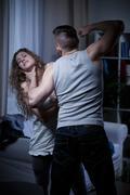 Choking defenseless woman - stock photo