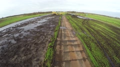 High tech stunt drone flying low over a metal plate road used for tracks 4k Stock Footage