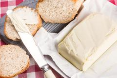 Fresh butter and bread Stock Photos