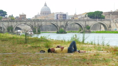 Stock Video Footage of immigrant sleeping on rome cityscape, refugee crisis, italy, 4k