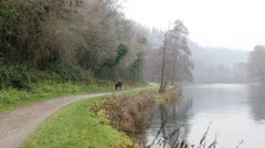 Husband and wife are walking in the ira river in the fog Stock Footage