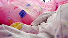 Fly the camera around a sleeping baby in a cradle lullaby Stock Footage