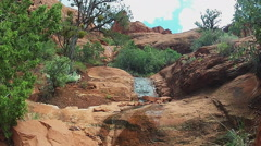 Small Stream Of Water Trickling Down Bell Rock- Sedona AZ Stock Footage