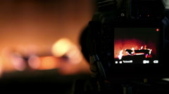 A process of indoor footage shooting with DSLR camera: working fireplace Stock Footage