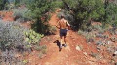 Thin Middle Aged Man Jogging In Arizona Desert- Sedona AZ- Slomo - stock footage