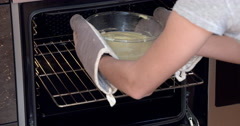 baking, girl putting cake into the oven - stock footage