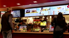 People ordering food at mcdonalds check out counter in Coquitlam BC Canada - stock footage