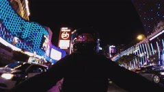 Man On Motorcycle Riding Past Casino Lights On Las Vegas Boulevard- Night Stock Footage