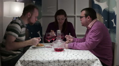 Friends sit at the table to eat and talk - stock footage