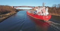 Cargo Vessel Passing Bridge In Kiel Canal Stock Footage