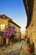 Castiglione della Pescaia, old street on sunset. Maremma Tuscany, Italy - stock photo