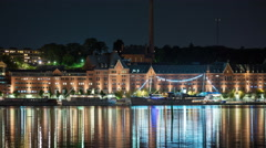 Time Lapse of Shoreline and Large Building at Night in Stockholm Sweden Stock Footage