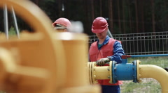 Workers tighten screws Stock Footage