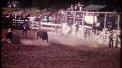 3069 fast & furious rodeo bull riding at local arena - vintage film home movie Stock Footage