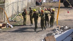 Israeli Homeland Security Soldiers carry a stretcher Stock Footage