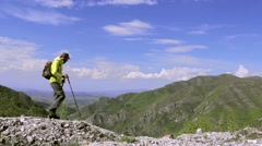 Male hiker in nature walking right on a straight rocky terrain. Dolly shot Stock Footage