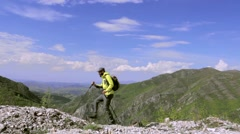 Male hiker in nature, walking left on a straight rocky terrain. Dolly shot - stock footage