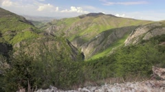 Hiker walking from left to right out of frame on a rocky terrain. Dolly shot - stock footage
