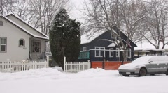 Winter street, snow, house, and cars Stock Footage
