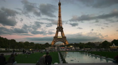 Two lovers watch the light display on the eiffel tower, paris Stock Footage