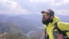 Hiker enjoying the view of a beautiful scenery. Dolly shot Stock Footage