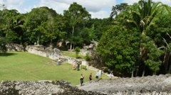 Tourists visit and climb temple steps at ancient Mayan ruins in Costa Maya, Stock Footage