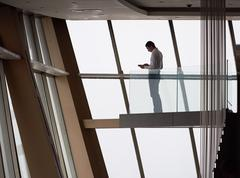 Young successful business man in penthouse apartment working on tbalet Stock Photos