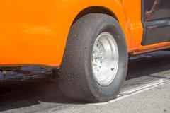 Slick tyre for drag racing car Stock Photos