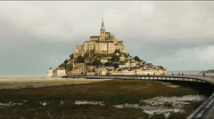 The walkway to mont st michel island, normandy Stock Footage