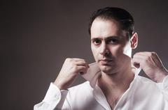 The brutal man in a white shirt - stock photo