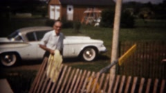 1964: Grandpa arrives in new white sports car to pool party.  BUFFALO, NEW YORK Stock Footage